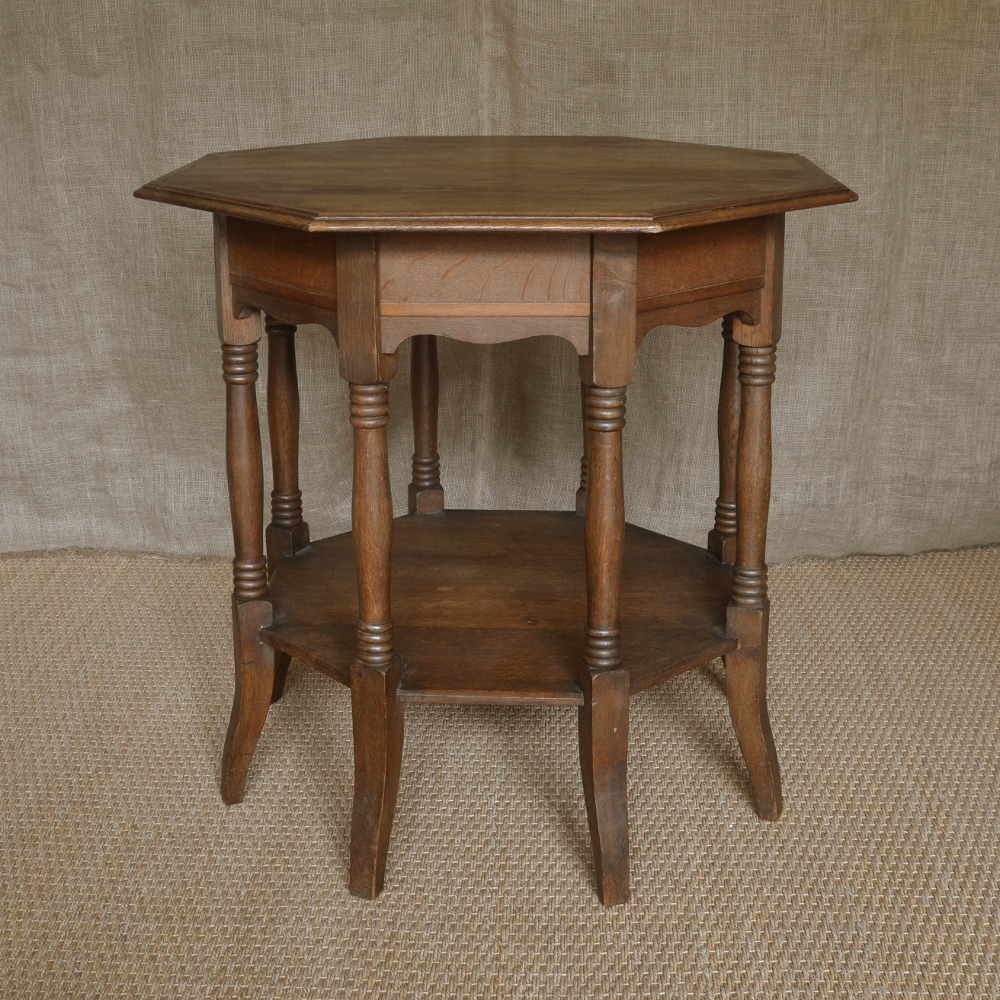 An oak octagonal occasional table for Occasional tables